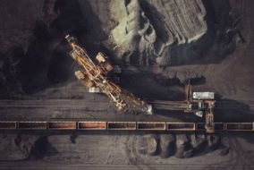 BHP Trims Iron Ore Production Forecast on Car Dumper Issues
